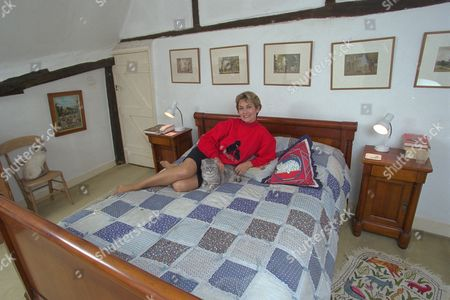 Actress Alexandra Bastedo On Her Bed At Her Country Home Near Chichester.