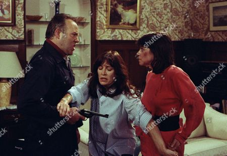 Siege at Home Farm - Reg and Viv argue with Reg blaming her for taking away everything he had but she insists the blame lies solely with him as he threw it away. Reg moves to shoot her but Shirley tries to intervene and ends up being shot - With Shirley Turner, as played by Rachel Davies ; Viv Windsor, as played by Deena Payne, and Reg Dawson, as played by Niven Boyd. (Ep 1875 - 7th June 1994).