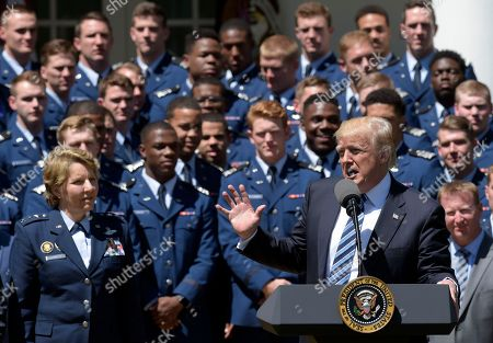 Donald Trump, Michelle Johnson Air Force Academy Superintendent Lt. Gen. Michelle Johnson, left, and football team members, listens as President Donald Trump speaks in the Rose Garden of the White House in Washington, during a presentation ceremony of the Commander-in-Chief trophy to the Air Force Academy football team