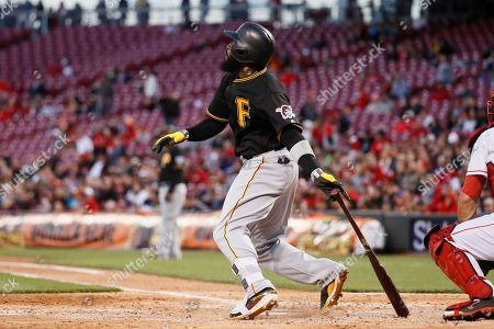Pittsburgh Pirates' Josh Harrison watches his three-run home run hit off Cincinnati Reds starting pitcher Scott Feldman in the fourth inning of a baseball game, in Cincinnati