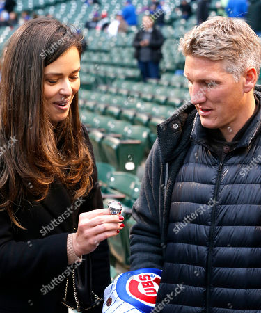 Bastian Schweinsteiger, Ana Ivanovic Chicago Fire soccer star Bastian Schweinsteiger, right, and his wife, former French Open tennis champion, Ana Ivanovic, look at Chicago Cubs legend Ryne Sandberg's World Series ring before a baseball game between the Cubs and the Philadelphia Phillies, in Chicago