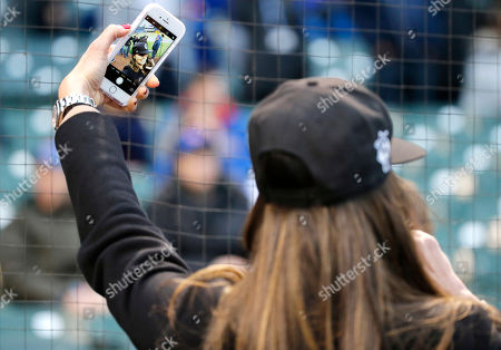 Former French Open tennis champion, Ana Ivanovic, wife of Chicago Fire soccer star Bastian Schweinsteiger, takes a selfie before a baseball game between the Cubs and the Philadelphia Phillies, in Chicago