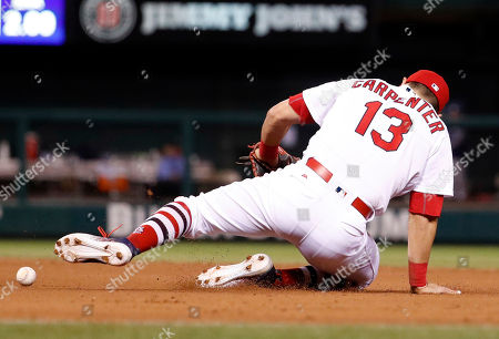 St. Louis Cardinals first baseman Matt Carpenter stops a ball hit by Milwaukee Brewers' Nick Franklin during the seventh inning of a baseball game, in St. Louis. Franklin reached base and Carpenter was charged with a fielding error on the play