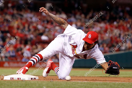 St. Louis Cardinals starting pitcher Carlos Martinez drops the ball after Milwaukee Brewers' Nick Franklin reached base on a fielding error by Matt Carpenter during the seventh inning of a baseball game, in St. Louis
