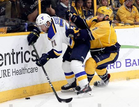 Yannick Weber, Vladimir Sobotka St. Louis Blues right wing Vladimir Sobotka (71), of the Czech Republic, and Nashville Predators defenseman Yannick Weber (7), of Switzerland, chase the puck during the first period in Game 4 of a second-round NHL hockey playoff series, in Nashville, Tenn