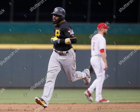 Pittsburgh Pirates' Josh Harrison runs the bases after hitting a three-run home run off Cincinnati Reds starting pitcher Scott Feldman in the fourth inning of a baseball game, in Cincinnati. The Pirates won 12-3