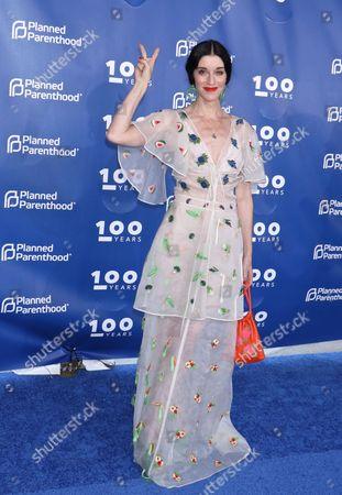 Sarah Sophie Flicker, wearing a Rosie Assoulin dress