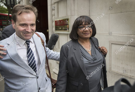 Shadow Home Secretary Diane Abbott is surrounded by reporters as she leaves Milbank Studios in Westminster, with the help of Lord Prescott's son David Prescott (left) after an appearance on the Daily Politics program
