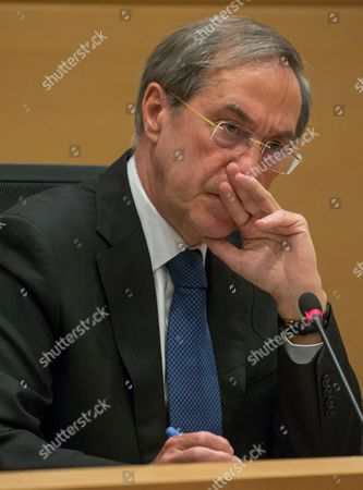 Stock Picture of Former French Interior Minister Claude Gueant (under Nicolas Sarkozy's Presidency) gestures during a parliamentary inquiry into the circumstances leading up to the adoption and application of the Law of 14 April 2011 on the criminal proceedings 'Kazakhgate' in Brussels, Belgium, 03 May 2017.