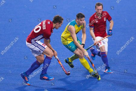 Stock Picture of Eddie Ockenden, Daniel Kyriakides, Barry Middleton Great Britain's Daniel Kyriakides, left, and Barry Middleton, right, battles for the ball against Australia's Eddie Ockenden, middle, during their men's field hockey match at the Sultan Azlan Shah Cup in Ipoh, Malaysia on