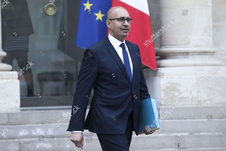 French Junior Minister for European Affairs Harlem Desir leaves after the weekly cabinet meeting