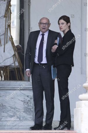 Stock Image of French Junior Minister for Francophony Jean-Marie Le Guen speaks with French Junior Minister for Victims Aid Juliette Meadel (R) after the weekly cabinet meeting