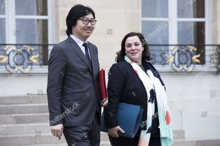 French Junior Minister for State Reform and Simplification Jean-Vincent Place (L) and French Housing Minister Emmanuelle Cosse leave after the weekly cabinet meeting