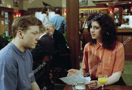 Elsa plays dirty with Nick as she meets him in The Woolpack and taunts him over being gay and throws a drink over herself, causing a scene and then accusing Nick of doing it - With Nick Bates, as played by Cy Chadwick, and Elsa Feldmann, as played by Naomi Lewis. (Ep 1878 - 16 June 1994).