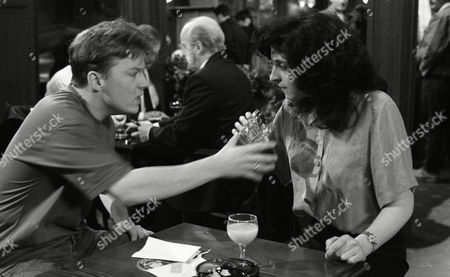 Stock Image of Elsa plays dirty with Nick as she meets him in The Woolpack and taunts him over being gay and throws a drink over herself, causing a scene and then accusing Nick of doing it - With Nick Bates, as played by Cy Chadwick, and Elsa Feldmann, as played by Naomi Lewis. (Ep 1878 - 16 June 1994).