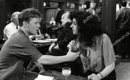 Stock Photo of Elsa plays dirty with Nick as she meets him in The Woolpack and taunts him over being gay and throws a drink over herself, causing a scene and then accusing Nick of doing it - With Nick Bates, as played by Cy Chadwick, and Elsa Feldmann, as played by Naomi Lewis. (Ep 1878 - 16 June 1994).