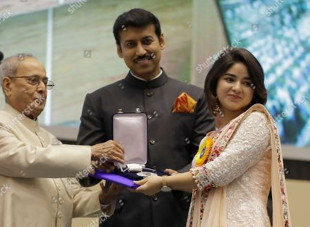 Indian President Pranab Mukherjee, left, and Junior Minister for Information and Broadcasting Rajyavardhan Singh Rathore present the Best Supporting Actress award to Zaira Wasim for her role in the film Dangal during the 64th National Film Awards in New Delhi, India, . Kapoor won the award for her role in the feature film Neerja