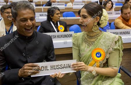 Bollywood actress Sonam Kapoor hands over a name plate to actor Adil Hussain during the 64th National Film Awards in New Delhi, India, . Kapoor and Hussain won the Special Jury Award for roles in their respective films