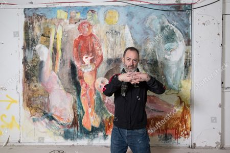 Scottish artist Douglas Gordon beside a mural in studio 40 at Glasgow School of Art. The mural was found after coverings were removed after the fire. (Please note that the mural is not the work of Douglas Gordon)