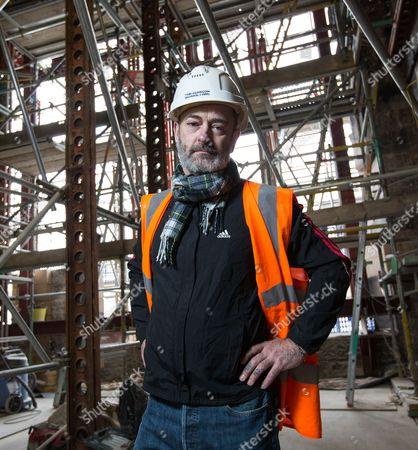 Scottish artist Douglas Gordon inside the fire damaged Mac library at Glasgow School of Art.