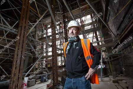 Stock Picture of Scottish artist Douglas Gordon inside the fire damaged Mac library at Glasgow School of Art.