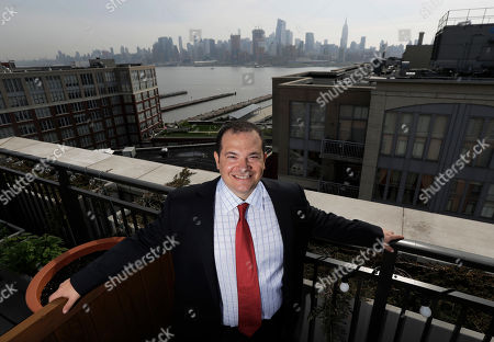 Carl Mazzanti, owner of eMazzanti, poses for a picture at his residence in Hoboken, N.J. Some customers of Mazzanti's computer networking and security company want to upgrade their systems, but it's been taking longer than expected the past few months to get banks to agree to finance the deals, says Mazzanti