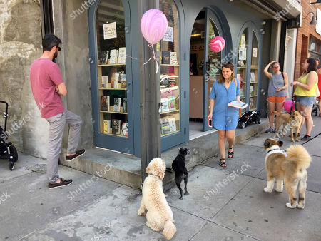 This photo shows people (and dogs) outside the new Books Are Magic bookstore in Brooklyn, New York, on the day it opened. The store is owned by novelist Emma Straub and her husband, who decided to open the store after another beloved neighborhood bookstore closed. Straub is one of a number of authors who own bookstores around the country, including Ann Patchett and Jeff Kinney