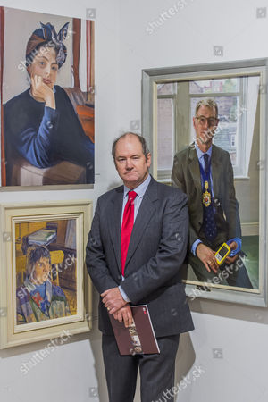 Ian Cryer with his portrait of Dame Margaret Drabble, bottom left