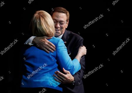 """Former """"Saturday Night Live"""" comedian and Joe Piscopo, right, gives a hug to New Jersey Lt. Gov. Kim Guadagno during his Radio Business Breakfast at Bergen County College, in Paramus, N.J. Piscopo announced he will not be launching an independent campaign to succeed Republican Gov. Chris Christie and will endorse Guadagno during her bid in the primary elections for gubernatorial race"""