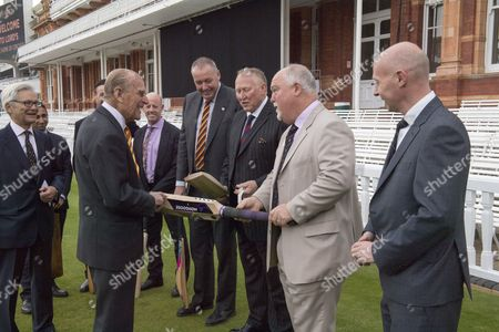 """Stock Picture of Former england cricket captain Mike Gatting shows Prince Philip an illegal short blade cricket bat Prince Philip said; """"thats an offensive weapon"""""""