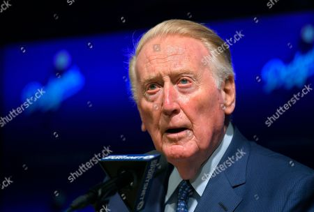 Hall of Fame broadcaster Vin Scully speaks to reporters about being inducted into the Los Angeles Dodgers Ring of Honor, prior to a baseball game between the Dodgers and the San Francisco Giants, in Los Angeles