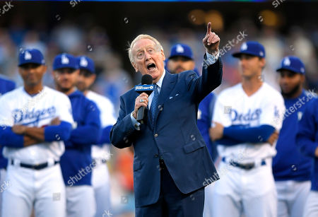 Los Angeles Dodgers broadcaster Vin Scully speaks during his induction into the team's Ring of Honor prior to a baseball game between the Dodgers and the San Francisco Giants, in Los Angeles