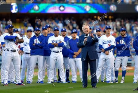 Broadcaster Vin Scully speaks during his induction into the Los Angeles Dodgers Ring of Honor, prior to a baseball game between the Dodgers and the San Francisco Giants, in Los Angeles