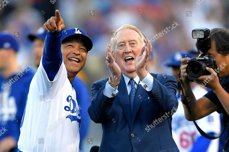 Vin Scully, Dave Roberts Broadcaster Vin Scully stands with Los Angeles Dodgers manager Dave Roberts during Scully's induction into the Los Angeles Dodgers Ring of Honor, prior to a baseball game between the Dodgers and the San Francisco Giants, in Los Angeles