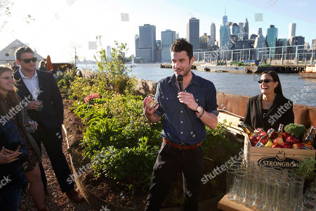 At a garden party celebrating the partnership between Strongbow Hard Apple Ciders and Swale, chef Sam Talbot, center, created custom Strongbow cocktails inspired by nature and mixed with edible herbs from the Swale garden, in New York