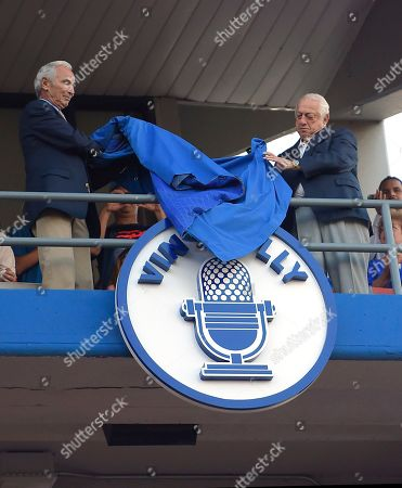 Sandy Koufax, Tommy Lasorda Former Los Angeles Dodgers' Sandy Koufax, left, and Tommy Lasorda unveil Hall of Fame broadcaster Vin Scully's plaque on the Los Angeles Dodgers Ring of Honor during an induction ceremony prior to a baseball game between the Dodgers and the San Francisco Giants, in Los Angeles