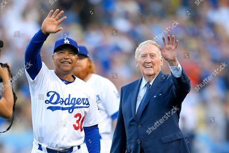 Vin Scully, Dave Roberts Broadcaster Vin Scully, right, stands with Los Angeles Dodgers manager Dave Roberts during his induction into the Los Angeles Dodgers Ring of Honor prior to a baseball game between the Dodgers and the San Francisco Giants, in Los Angeles
