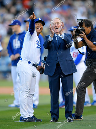 Vin Scully, Dave Roberts Hall of Fame broadcaster Vin Scully, right, stands with Los Angeles Dodgers manager Dave Roberts during his induction into the Los Angeles Dodgers Ring of Honor prior to a baseball game between the Dodgers and the San Francisco Giants, in Los Angeles