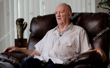 """Former boxer Chuck Wepner talks to The Associated Press in his home in Bayonne, N.J. Forty-two years after he stepped into the ring against Muhammad Ali as a 40-to-1 underdog, Wepner's business card still has a picture of the moment when he knocked down the champ. Wepner's life story has now arrived on the big screen with Liev Schreiber playing the Bayonne Bleeder in """"Chuck,"""" which opens on Friday, May 5, 2017, in New York and Los Angeles before expanding nationwide"""