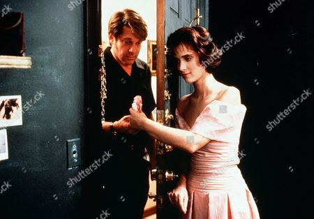 'Welcome Home, Roxy Carmichael'  Film - 1990 -  Dinky (Winona Ryder) holds the door open for her father, Les Bossetti (Graham Beckel) and hands him something