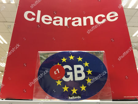 Stock image of a clearance sale of gb eu car bumper stickers at a halfords car