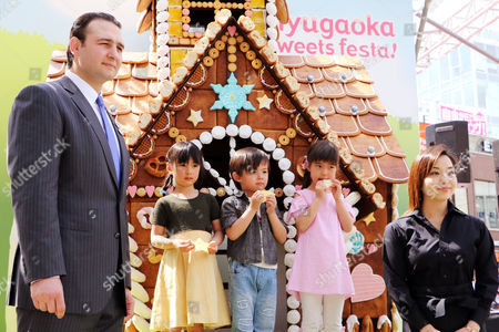 Stock Image of Former Bulgarian sumo champion or Ozeki Kotooshu (L) who was named as the sweet ambassador, Japanese confectionery artist Junko Tanaka (R) and children