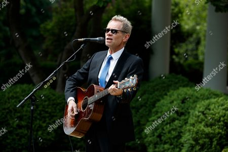 Donald Trump, Steven Curtis Chapman Musician Steven Curtis Chapman performs in the Rose Garden of the White House in Washington, during a ceremony where President Donald Trump signed an executive order aimed at easing an IRS rule limiting political activity for churches