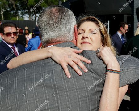 Barbara Poma, Buddy Dyer Pulse nightclub owner Barbara Poma, right, embraces Orlando mayor Buddy Dyer after a news conference announcing plans for a memorial at the site, in Orlando, Fla. Poma said the site will become a memorial and a museum to honor the 49 people who were killed and the dozens more who were injured during the worst mass shooting in modern U.S. history