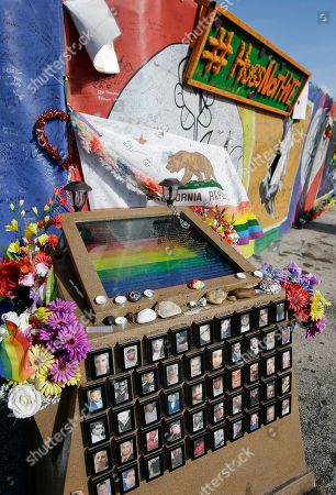 A small memorial with the names and photos of the victims of the Pulse nightclub shooting sits in front of the site, in Orlando, Fla. Pulse nightclub owner Barbara Poma said the site will become a memorial and a museum to honor the 49 people who were killed and the dozens more who were injured during the worst mass shooting in modern U.S. history