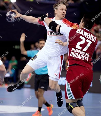 Stock Photo of Morten Olsen of Denmark in action against against Bence Banhidi (R) of Hungary during the men's EHF European Championship qualification handball match between Hungary and Denmark at Papp Laszlo Budapest Sports Arena in Budapest, Hungary, 04 May 2017.