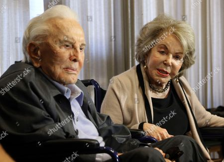 Kirk Douglas, Anne Douglas Kirk and Anne Douglas talk, in Los Angeles during a party celebrating his 100th birthday. The couple was also celebrating their upcoming 63rd wedding anniversary and the 25th anniversary of Anne's 1992 gift that funded the Anne Douglas Center for homeless women