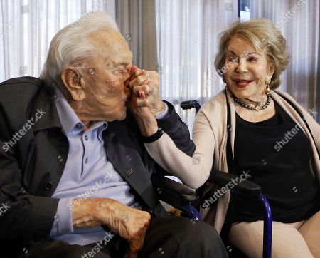 Kirk Douglas, Anne Douglas Kirk Douglas kisses his wife Anne's hand, in Los Angeles during a party celebrating his 100th birthday. The couple was also celebrating their upcoming 63rd wedding anniversary and the 25th anniversary of Anne's 1992 gift that funded the Anne Douglas Center for homeless women