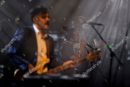 """Members of the Mexican rock band Cafe Tacuba, from left, bass guitarist Enrique """"Quique"""" Rangel, lead singer Ruben Albarran, center, and pianist Emmanuel """"Meme"""" del Real perform during a media event promoting their new album """"Jei Beibi,"""" in Mexico City, . Cafe Tacuba is embracing its newfound independence with the release of the Mexican rock band's first album without a label in its nearly three-decade career. """"Jei Beibi"""" will be released on May 5, 2017"""