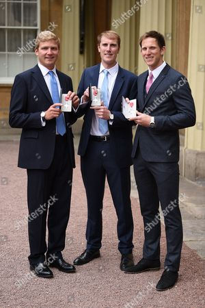 Left to right rowers Constantine Louloudis, George Nash and Matt Langridge with their MBE's after the investiture service at Buckingham Palace